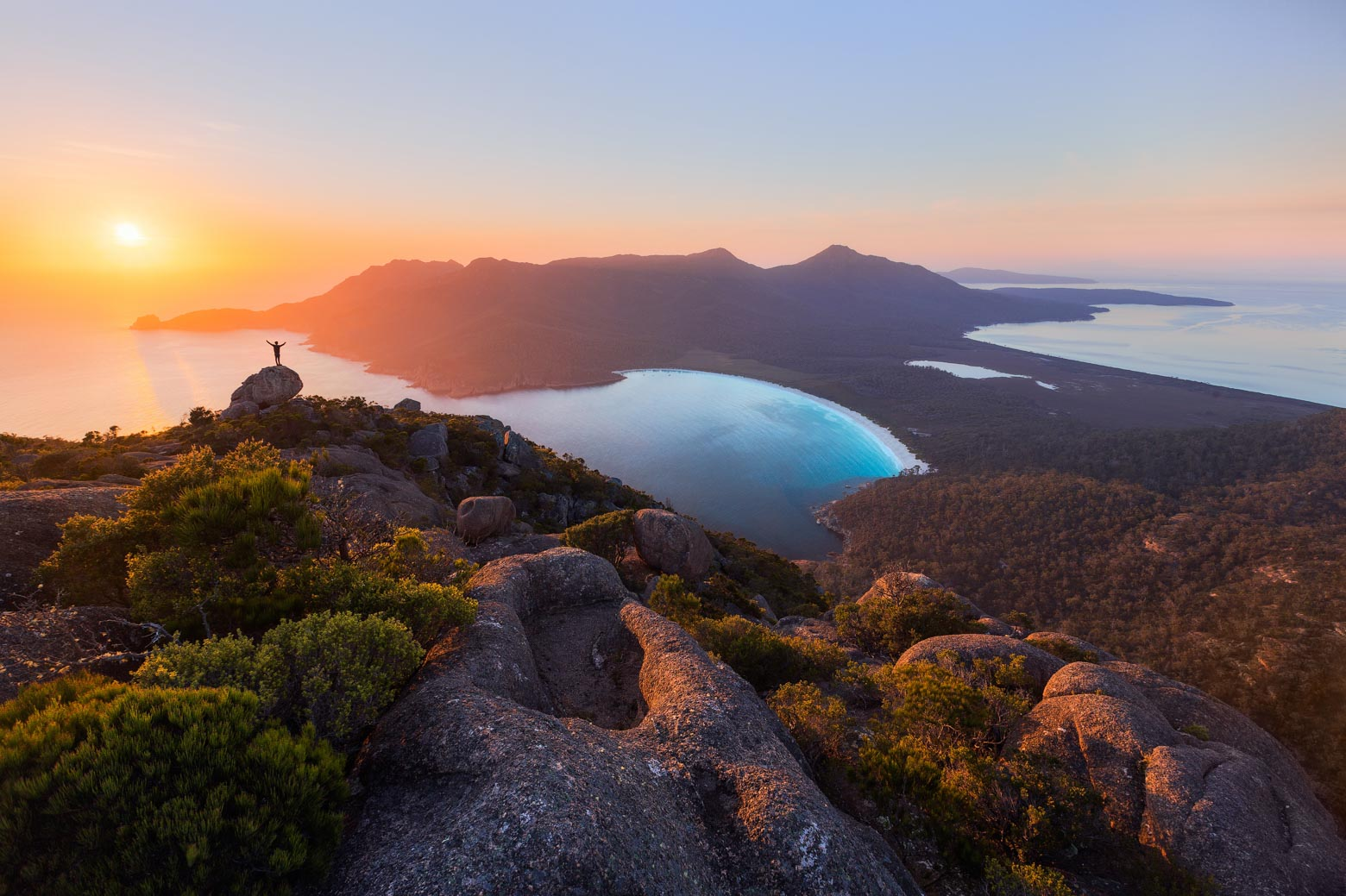 See a magnificent sunrise from Mt Amos on your Lap of Tasmania road trip
