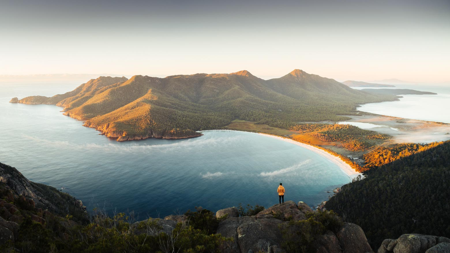 Looking down on Wineglass Bay from Mt Amos on your Lap of Tasmania road trip