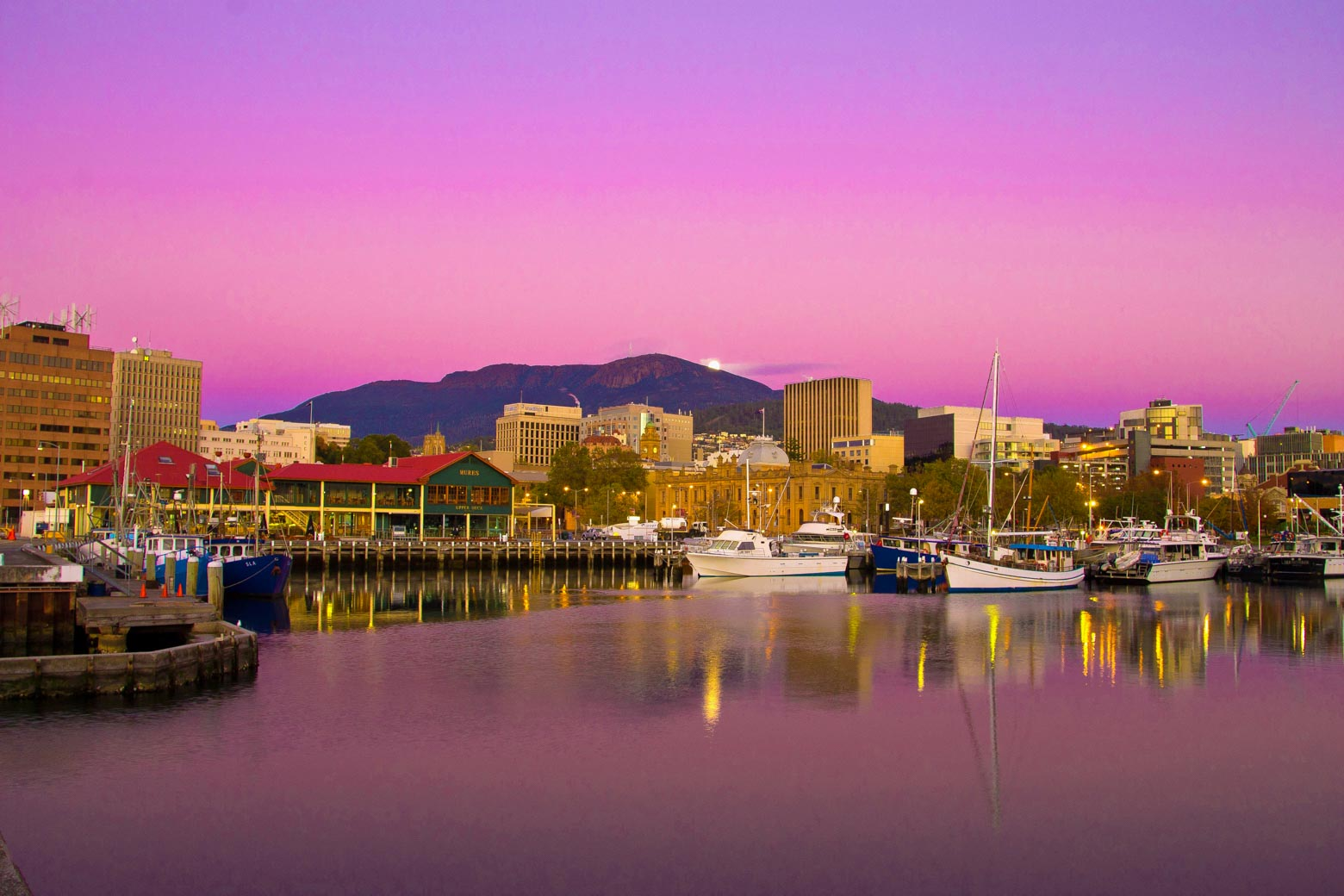 Stunning Hobart accommodation on the waterfront at sunset on your Lap of Tasmania road trip