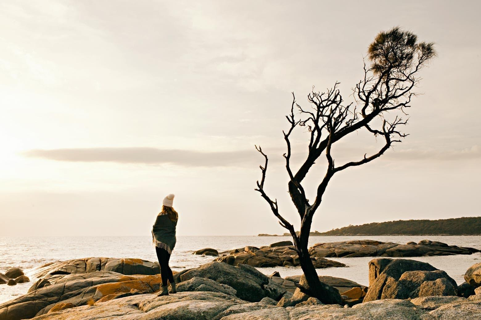 Lone tree and girl at Binalong Bay (Bay of Fires) - Tasmania itinerary (7 days)