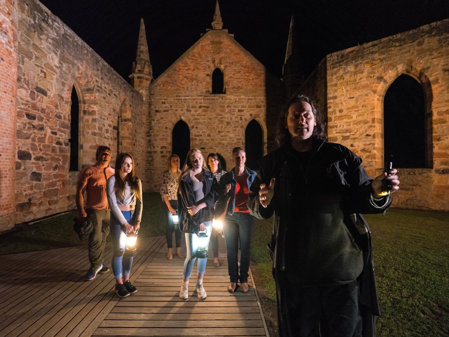 Man telling ghost stories at Port Arthur Historic Site on the Port Arthur Ghost Tour